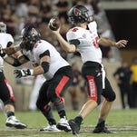 Ball State quarterback Riley Neal passes against Texas A&M in the second half Saturday night at Kyle Field. Neal was 11-of-19 passing for 116 yards.