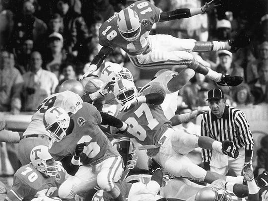 News Sentinel Archive Tennessee defensive back Dale Carter, top, leaps over the pile in an attempt to block an extra point against Notre Dame during the 1990 game at Neyland Stadium.