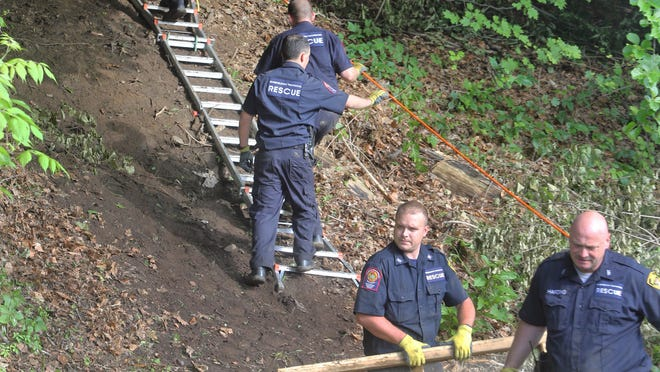 Greenburgh police officers remove equipment used at the site of an excavation off of route 9A in Greenburgh June 11, 2014.