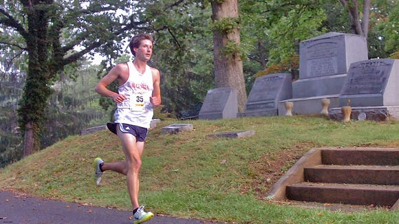 A runner passes by the gravesite of Thomas Wolfe during a previous Thomas Wolfe 8K race. Asheville's oldest race is Saturday, Oct. 17, in downtown.