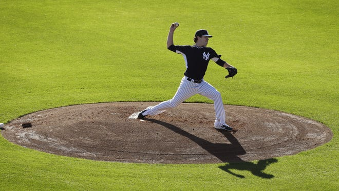 Yankees starting pitcher David Phelps throws a pitch during spring-training practice Monday  in Tampa, Fla.