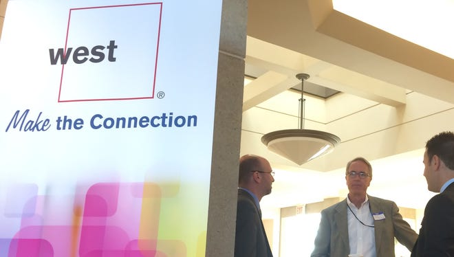 West Corp. celebrated the grand opening of its new location at 1200 Hansen Road on Tuesday, Oct. 7, 2014. The company expects to employ 250-300 people at the site.