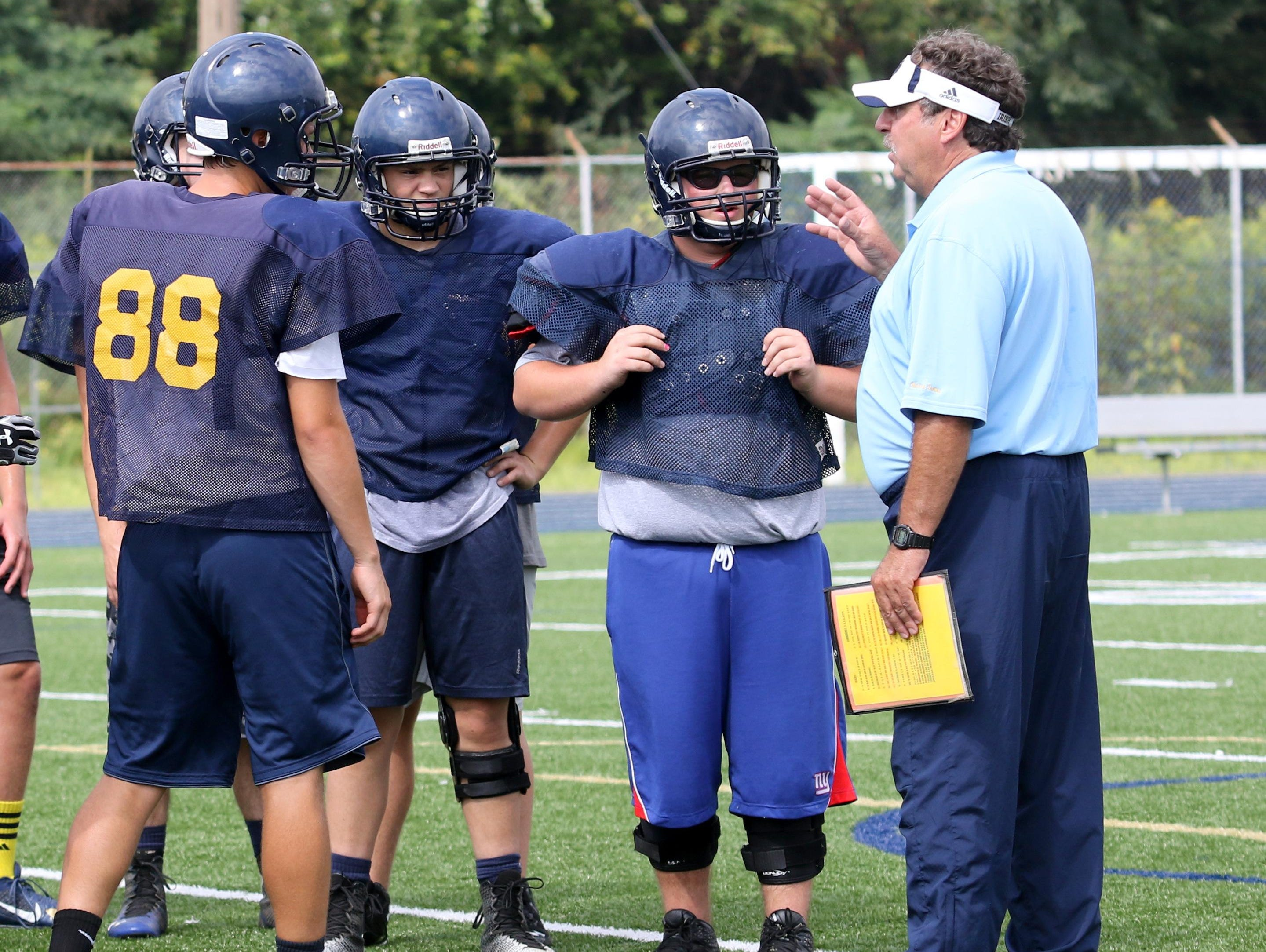 Notre Dame head coach Mike D'Aloisio instructs his players during a recent practice at Brewer Memorial Stadium.