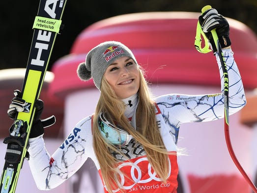Lindsey Vonn laughs during a ceremony after the downhill
