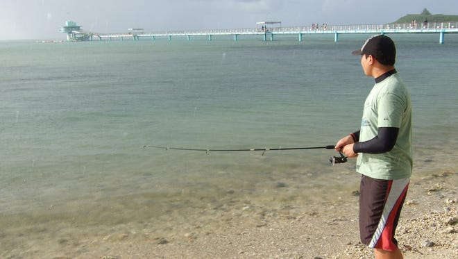 Alvin Quenga fishes at the Piti Bomb Holes in this Pacific Daily News file photo. The Piti preserve and the Achang Reef Flat Marine Preserve are open for limited fishing.