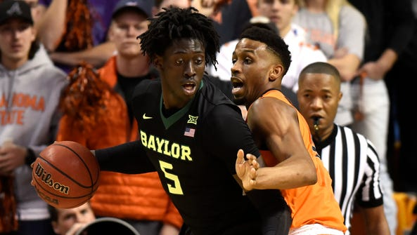 Oklahoma State forward Leyton Hammonds, right, defends