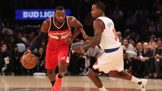 Washington Wizards guard John Wall (2) dribbles the ball past New York Knicks guard Brandon Jennings (3) during the first quarter at Madison Square Garden on Monday, Oct. 10, 2016.