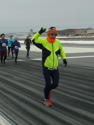 Bob Kopac crosses the finish line of the Pilots for LLS 5K on the Runway at Stewart International Airport in New Windsor.