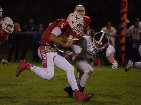 Wall Twp. QB Eddie Scott is brought down by Middletown Souths #1 Sampson Dube in 1st quarter action. Photo by