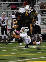 Newbury Park's Ryan Matlock is taken down by the Calabasas defense during Friday night's game.