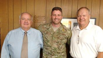 Tech Sgt. Timothy A. Officer Jr. (center)