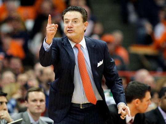 "In this  Monday, Feb. 13, 2017 file photo, Louisville head coach Rick Pitino yells to his players in the second half of an NCAA college basketball game against Syracuse in Syracuse, N.Y. Rick Pitino has sued the school's University of Athletic Association for $38.7 million, Thursday, Nov. 30, 2017. The former Cardinals coach says the ULAA breached his contract by placing him on unpaid administrative leave without notice and firing him last month with no legally justified ""cause."" Pitino's lawsuit filed Thursday in U.S. District Court seeks liquidated contract damages of $4.307 million through 2026. (AP Photo/Nick Lisi, File)"