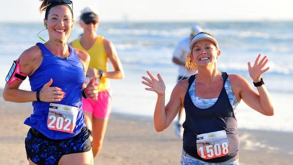 Hundreds of runners come out early Sunday morning to enjoy a run on the beach for the 10K and half marathon distance for the USA Beach Running Championship held at Shephard Park in Cocoa Beach.