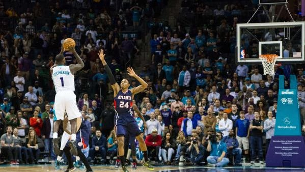 Charlotte Hornets guard Lance Stephenson (1) hits the game winning shot in double overtime against the Atlanta Hawks at Time Warner Cable Arena. Charlotte defeated Atlanta 122-119 in double overtime.
