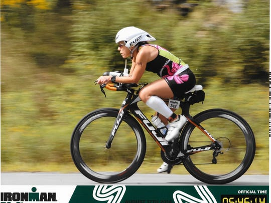 Sardina-Kelly rolls through the biking portion of the Timberman 703 Half-Ironman race.