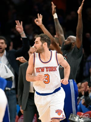 The Knicks bench celebrates in the background after Jose Calderon (3) hit a 3-pointer in the fourth quarter Monday against the New Orleans Pelicans at Madison Square Garden in New York. The Knicks won 99-92.