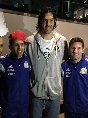 Luis Scola poses with Javier Mascherano, Sergio Aguero and Lionel Messi.