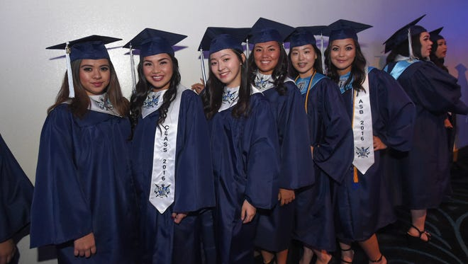 Graduating candidates get together for a group picture during the St. Paul Christian School Commencement Exercise at the Dusit Thani Guam Resort in Tumon on May 14.