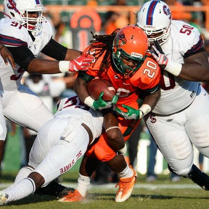 FAMU junior running back Tevin Spells is tackled by