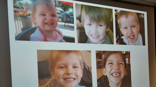 Photos of Timothy Ray Jones Jr.'s children are on display during a news conference at the Lexington County Sheriff's Department Training Center in Lexington, S.C., Sept. 10.  Jones, 32, will be charged with murder in the deaths of his five children after he led authorities to a secluded clearing in Alabama, where their bodies were found wrapped in garbage bags.