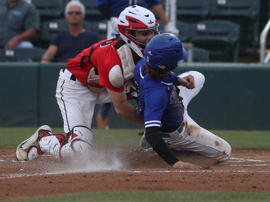 Canterbury scores a run as NFC catcher Carson Neal tries to make a tag during Thursday's Class 3A state championship in Fort Myers.