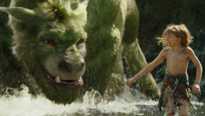 """Oakes Fegley gets a little help from a big friend in """"Pete's Dragon."""""""