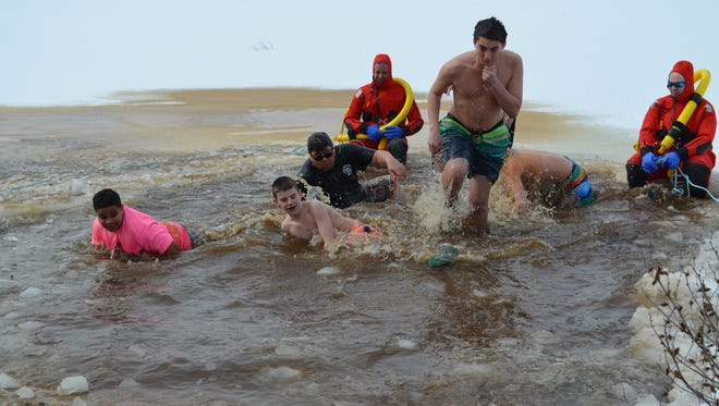 Swimmers participate in Millville's 12th annual Snowflake Swim at Union Lake. This year's event will be held Feb. 13.