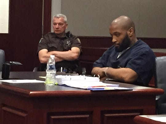 Murder suspect Ujuan Burton, 31, of Oak Park sits in court during his preliminary exam April 20, 2015, in 41B District Court in Clinton Township.