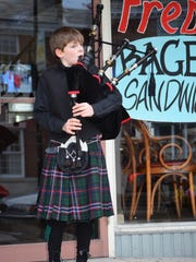 Talon Jones, 11, of Mullica plays the bagpipes on Bellevue Avenue in Hammonton during Third Thursday.