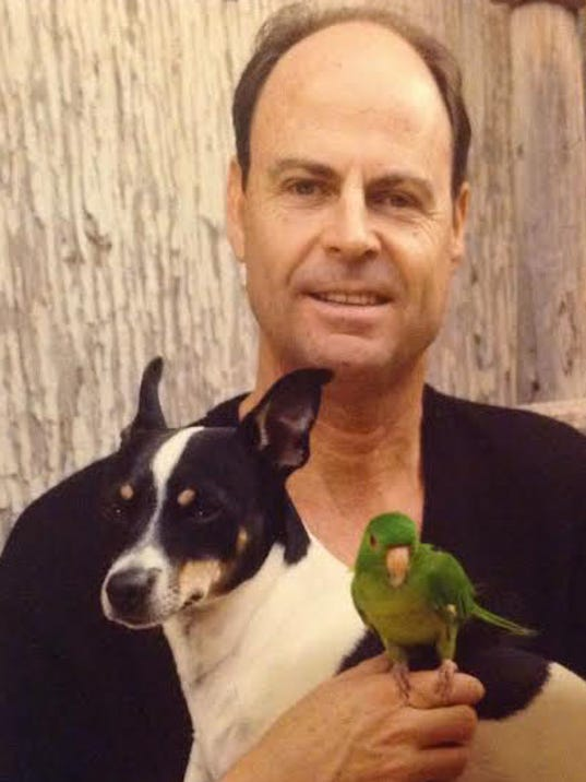 Donny Grooms hold on to Jack, his rat terrier, and a bird. Grooms and Jack were recently reunited after Jack went missing for several days.