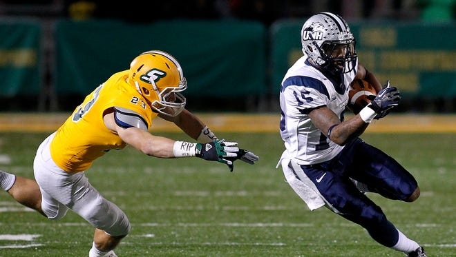 New Hampshire wide receiver R.J. Harris (15) runs past Southeastern Louisiana defensive back Tyler Stoddard (23) during the second half of an NCAA college football Division 1 championship quarterfinal game in Hammond, La., Saturday, Dec. 14, 2013. New Hampshire won 20-17.