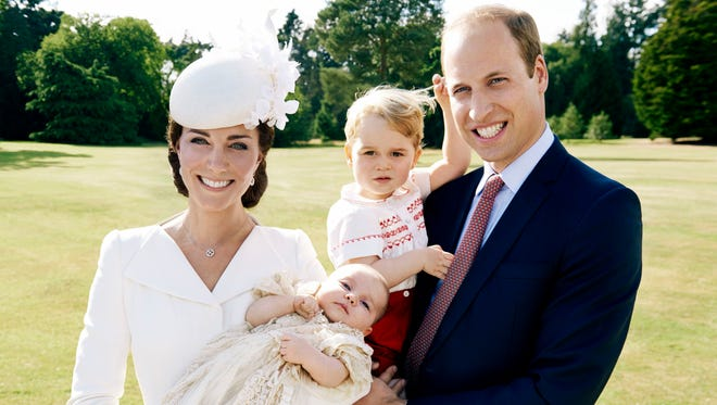Britain's Prince William, and Kate, Duchess of Cambridge, hold their children, Prince George, and Princess Charlotte on  the grounds of Sandingham House in England after the christening of the princess on Sunday, July 5, 2015.