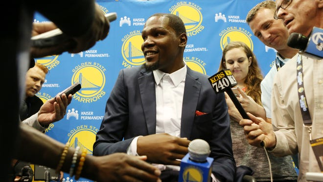 Golden State Warriors' Kevin Durant speaks with reporters after he was introduced during a news conference at the NBA basketball team's practice facility, Thursday, July 7, 2016, in Oakland, Calif.