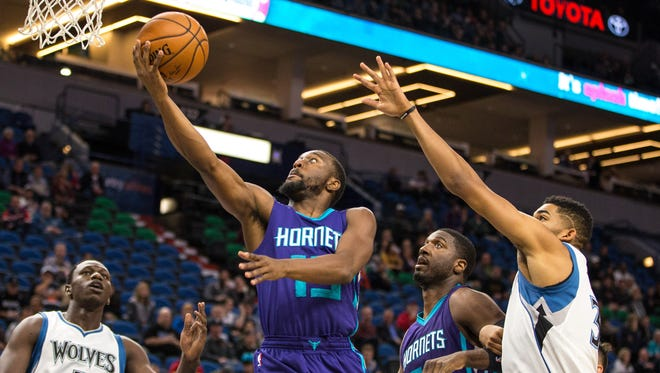 Charlotte Hornets guard Kemba Walker shoots during the first quarter against the Minnesota Timberwolves at Target Center.