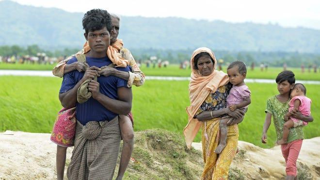 Rohingya Muslim refugees walk to Bangladesh