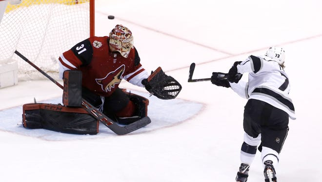 Los Angeles Kings center Tyler Toffoli (73) shoots wide of Arizona Coyotes goaltender Adin Hill (31) during a shootout of an NHL hockey game Tuesday, March 13, 2018, in Glendale, Ariz. The Coyotes defeated the Kings 4-3 in a shootout.