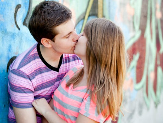Stanfords Not The Only School With Kissing Traditions 147512485 Young Couple Kissing