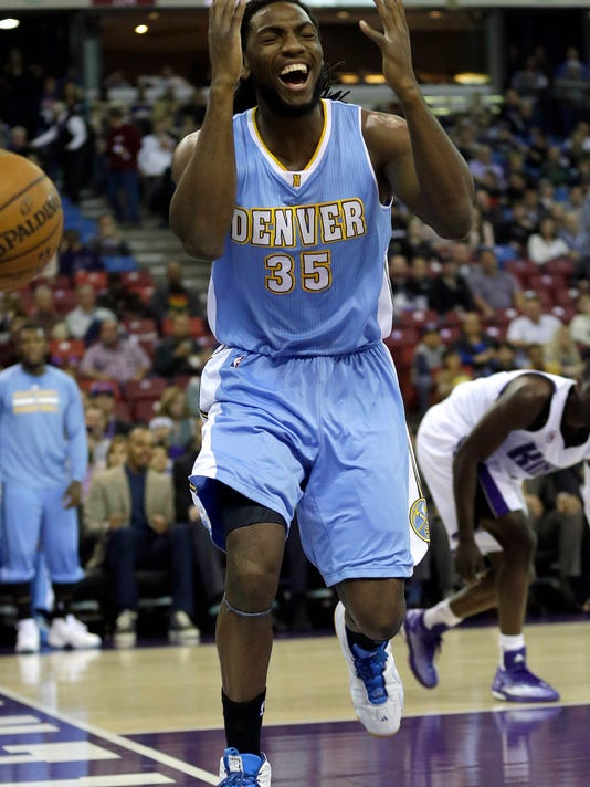 Denver Nuggets forward Kenneth Faried, reacts after losing the ball out of bounds against the Sacramento Kings during the first quarter of an NBA basketball game in Sacramento, Calif., Friday, Jan. 9,  2015. (AP Photo/Rich Pedroncelli)