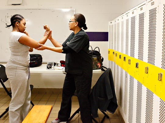 A'Nyah Wray, 14, left, of North York Borough, is given