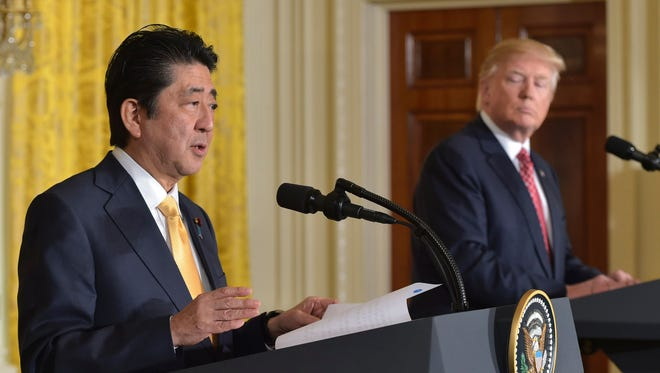 President Donald Trump and Japanese Prime Minister Shinzo Abe hold a joint press conference on February 10, 2017, at the White House.
