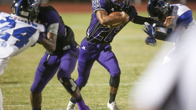 Shadow Hills runner Lee Hawkins breaks through for a touchdown on the first play of the game against Cathedral City, September 21, 2017.