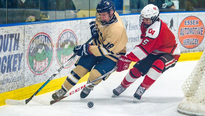 Essex's Will Couture, left, is chased by Champlain Valley Union's Jake Schaefer in Essex Junction on Saturday, March 3, 2018.