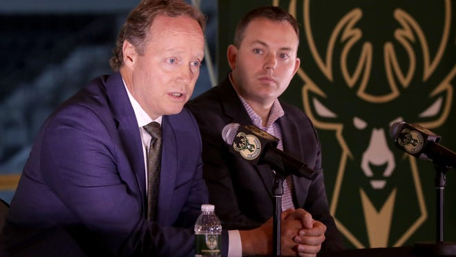 The Milwaukee Bucks new head coach, Mike Budenholzer, left, answers media questions next to general manager Jon Horst during the introductory press conference.   BUCKS22 BUCKS - The Milwaukee Bucks introduced their new head coach, Mike Budenholzer, at the future Bucks arena in Milwaukee on Monday, May 21, 2018.  -  Photo by Mike De Sisti / Milwaukee Journal Sentinel