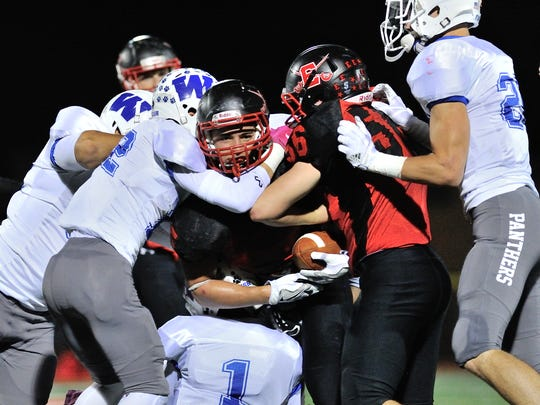 Wallington's defense converges on Emerson's Ryan Shaw on Friday night, Oct. 6, 2017, in Emerson. Wallington won, 28-19 and Wallington is 4-0 and in command of the NJIC Patriot Division.