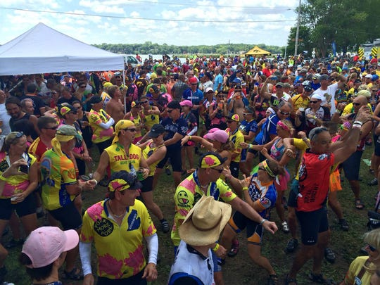 Riders do the wobble at the Iowa Craft Beer tent in Ventura Wednesday as RAGBRAI rolls towards Mason City July 23, 2014.