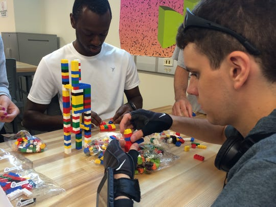 Luigi Milca, front, and Myles Robinson work with LEGOs in a new design lab at Purdue University's College of Technology. The freshmen are students in the college's new competency-based degree program.