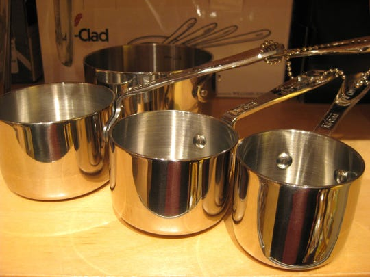 These All-Clad measuring cups have all the heft of miniature saucepans (and will set Santa back about $50).