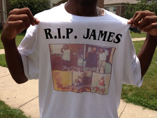 A T-shirt made in memory of James Johnson, who was shot and killed at Hawthorne Place Apartments, displays his date of death. Nearly 20 of Johnson's friends gathered at the complex after his funeral July 16.
