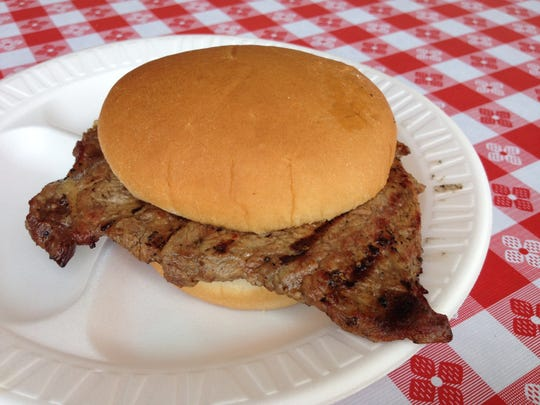 A true Hoosier Rib-eye Steak Sandwich requires quarter-pound, boneless, USDA Choice, thin rib-eye slice, trimmed of all fat and surrounding meat known as the cap and the tail or lip. The Indiana Beef Cattle Association Cattlemen's Club has prepared and sold rib-eye sandwiches at the fair each year since 1983.The club sells so many that they've tradmarked the sandwich's name. Find the club's huge tent on the track's back stretch.