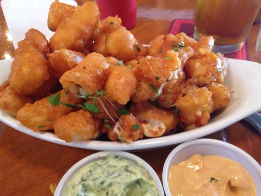 Stop 3: Cheese curds are a must at Twenty Tap. Served with your choice of aioli sauces.